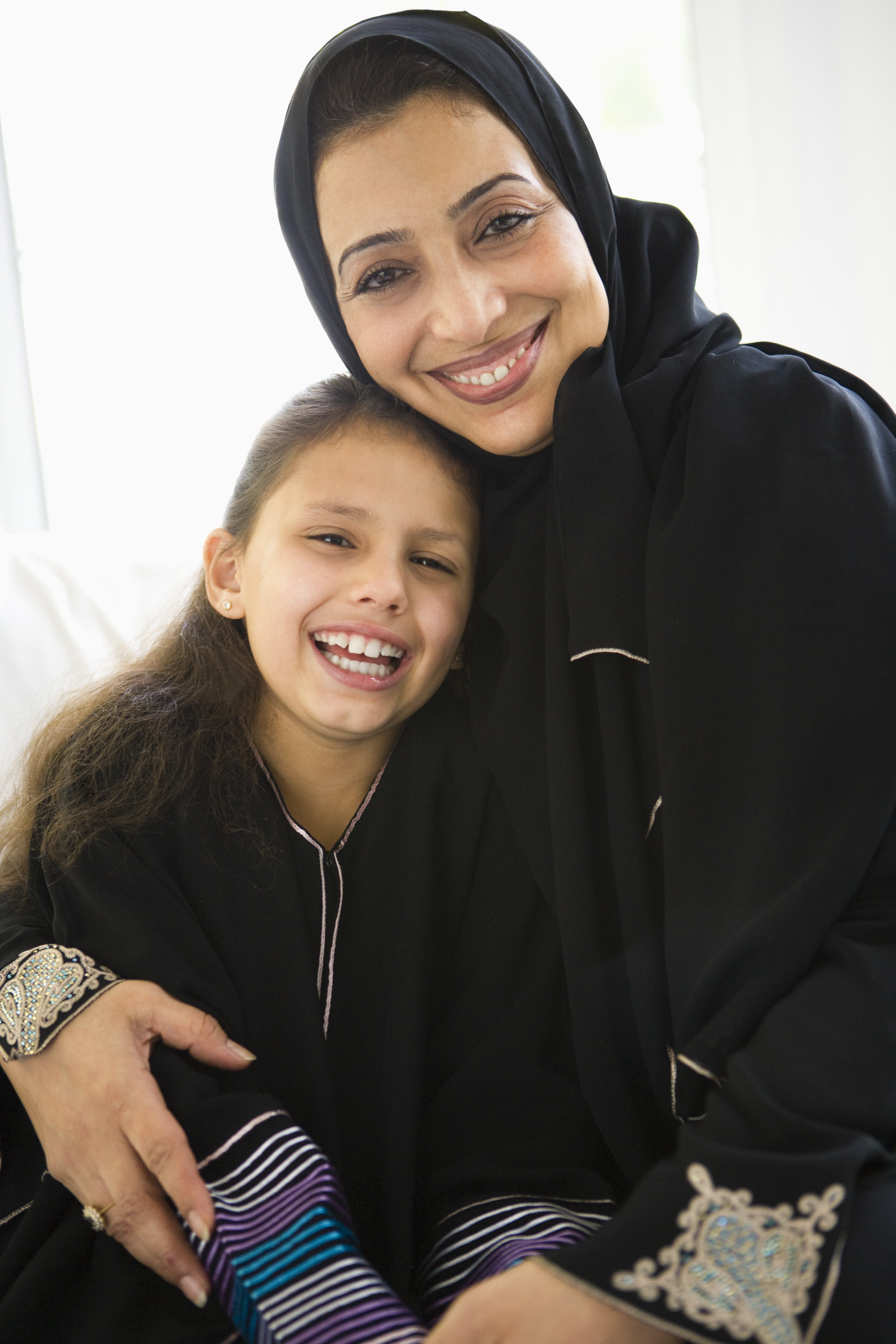 A Middle Eastern woman with her granddaughter